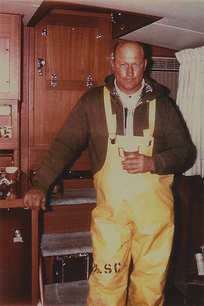 Photo of John in yellow overalls